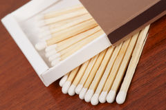 Matches on wooden surface Stock Images