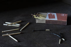 Matches. On the wooden table are a match Stock Image