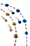Matching. Earings and necklace in blue and yellow stock images
