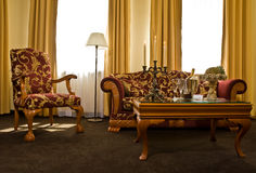 Matching antique furniture. A view of beautiful matching antique furniture in a luxury hotel room stock photo