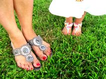 Matching Mommy daughter pretty feet royalty free stock image