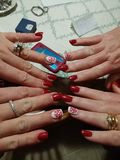 Matching Nail Designs. Fingernail Art by Two Different Designers Royalty Free Stock Photography