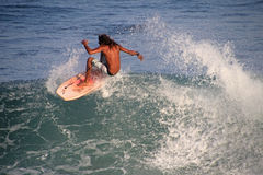 Matchless boogie boarder standing on the board and surfing, El Zonte beach, El Salvador Royalty Free Stock Images