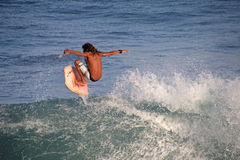 Matchless boogie boarder standing on the board and surfing, El Zonte beach, El Salvador Stock Photos