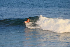 Matchless boogie boarder standing on the board and surfing, El Zonte beach, El Salvador Stock Images