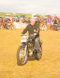 Matchless vintage motorbike at Roseisle. An image of a 1958 Matchless trials vintage motor bike being ridden by the proud owner round the ring at the Roseisle Royalty Free Stock Photography
