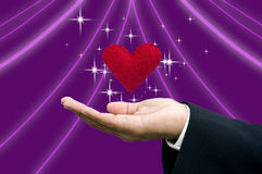 Matchmaker's hand with heart Stock Photography