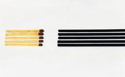 Matchpinnar som vänder mot rökelsepinnar Royaltyfria Bilder