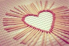 Matchs dans la forme d'amour Photographie stock