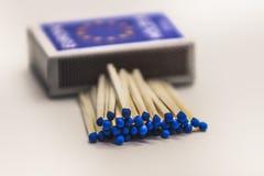 Matchs et boîte bleus Photo libre de droits