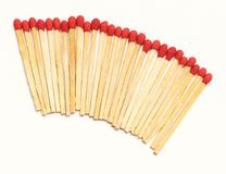 Matchstick arrange in a row on white background.  Stock Photos