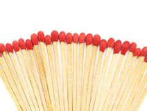 Matchstick arrange in a row on white background. The matchsticks are scattered Royalty Free Stock Images