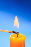 Matchstick burning candle closeup Stock Photography