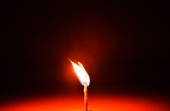 Matchstick. The burning matchstick in the table Royalty Free Stock Photo