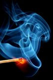 Matchstick bursting to flame Stock Photos