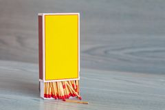 Matchstick on color wood. Table stock photo