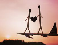 Matchstick couples flying over the world stock photo