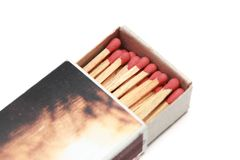 Matchstick in een lucifersdoosje Stock Foto