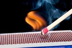 Matchstick en el fuego Foto de archivo