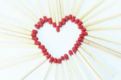 Matchstick heart on white background Royalty Free Stock Photo