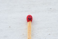 Matchstick and his smile Royalty Free Stock Image