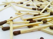 Matchstick out of matchbox on white background. Wood closeup white stock photography