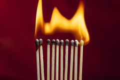 Matchsticks on fire. Stock Photos
