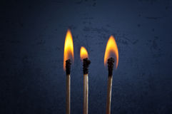 Matchsticks with flame Royalty Free Stock Images