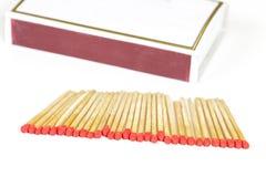Matchsticks i pudełko na odosobnionym tle Obrazy Royalty Free