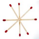 Matchsticks mit den roten Köpfen gruppiert in einem Stern Stockfoto