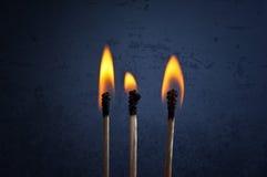 Matchsticks mit Flamme Lizenzfreie Stockbilder