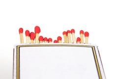 Matchsticks och ask på isolerat Royaltyfri Fotografi