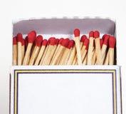 Matchsticks och ask på isolerat Fotografering för Bildbyråer