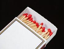 Matchsticks och ask på isolerat Royaltyfria Bilder