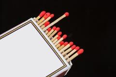 Matchsticks och ask på isolerat Royaltyfria Foton
