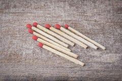 Matchsticks på trä Royaltyfri Fotografi