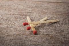 Matchsticks på trä Fotografering för Bildbyråer