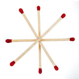 Matchsticks with red heads grouped in a star Stock Photo