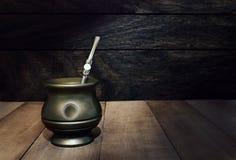 Mate bottle on wood. Dark background Royalty Free Stock Image