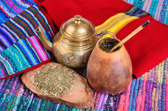 Mate in calabash. �up from calabash and teapot with dry mate leaves.Traditional drink of Peru, Brazil and Argentina royalty free stock photos