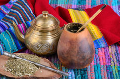 Mate in calabash. Cup from calabash and teapot with dry mate leaves.Traditional drink of Peru, Brazil and Argentina royalty free stock photography