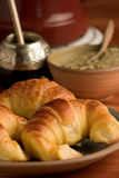 Mate and croissants. Yerba mate infusion and croissants (Medialunas), Argentine style stock images