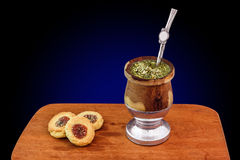 Mate Cup. A cup of traditional Argentinian Mate with cookies Royalty Free Stock Photography