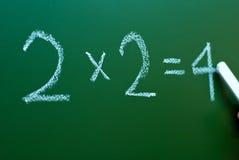 Matemáticas en una pizarra Foto de archivo libre de regalías