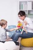 Matematik hemma med pedagogen Royaltyfri Fotografi