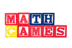 Matematik spelar - alfabetet behandla som ett barn kvarter på vit Royaltyfri Foto