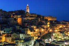 Matera-Felsen bis zum Nacht Stockbilder
