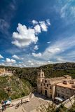 Cityscape view of Matera, Italy from above. MATERA, ITALY - AUGUST 27, 2018: High angle summer day panoramic view over Church of Saint Peter or Chiesa di San stock image