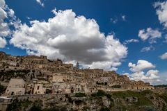 Sunny summer day street view of Matera, Italy. MATERA, ITALY - AUGUST 27, 2018: Summer day scenery street view of the amazing ancient town of the Sassi with stock photography