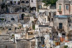 Wonderful architecture and history, Matera, Italy. MATERA, ITALY - AUGUST 27, 2018: Warm scenery summer day high angle close-up street view of amazing ancient royalty free stock image